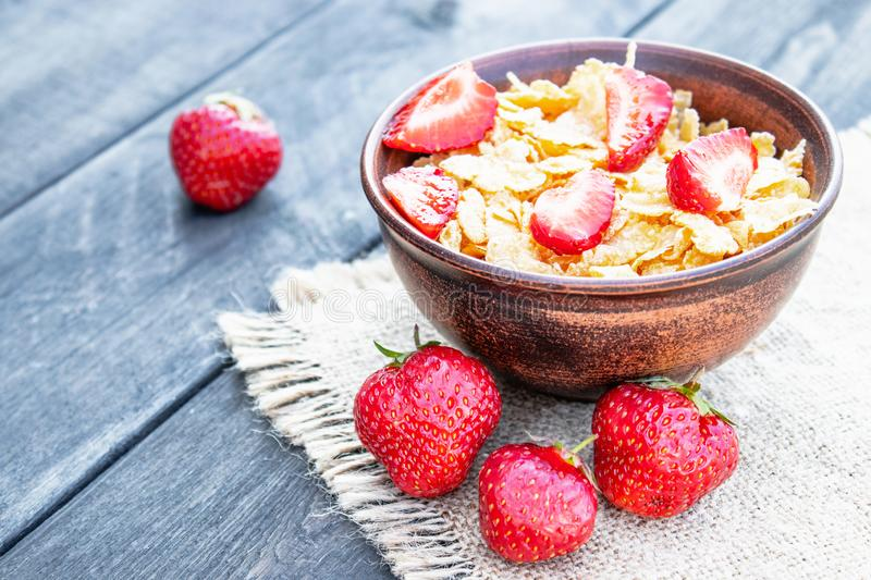 Fresh homemade muesli, muesli with strawberries in a plate on a dark gray background, selective focus royalty free stock photos