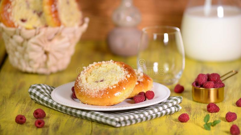 Fresh homemade open patties with cottage cheese. Traditional Russian pastry vatrushka, round buns with raspberries.  stock photo