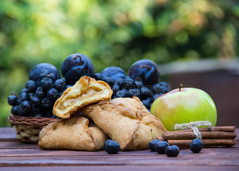 Fresh homemade pies with apples and cinnamon. stock photo