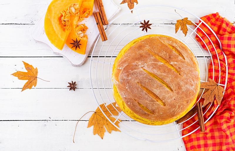 Fresh homemade pumpkin bread and pumpkin slices. Top view royalty free stock photos