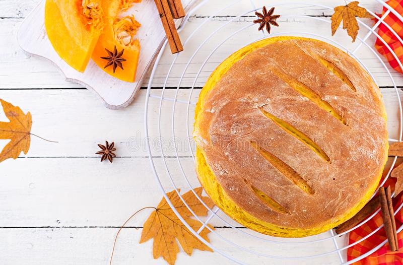 Fresh homemade pumpkin bread and pumpkin slices. Top view stock image