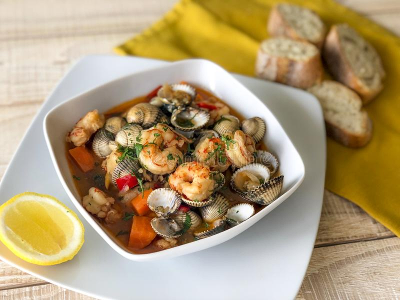 Fresh homemade seafood stew casserole. Fresh homemade seafood stew prepared in a casserole with bread royalty free stock images