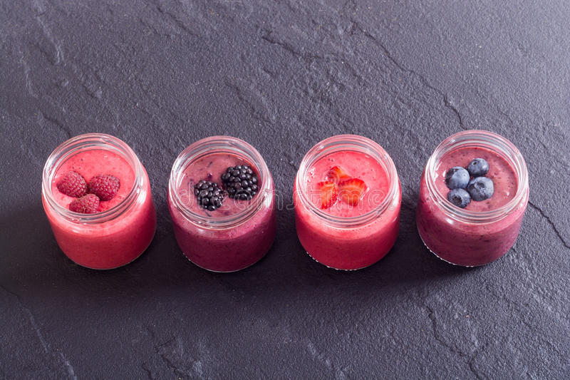 Fresh homemade smoothies. With berries on rustic background stock photography
