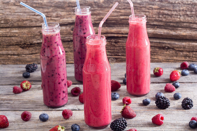 Fresh homemade smoothies. With berries on rustic background royalty free stock image