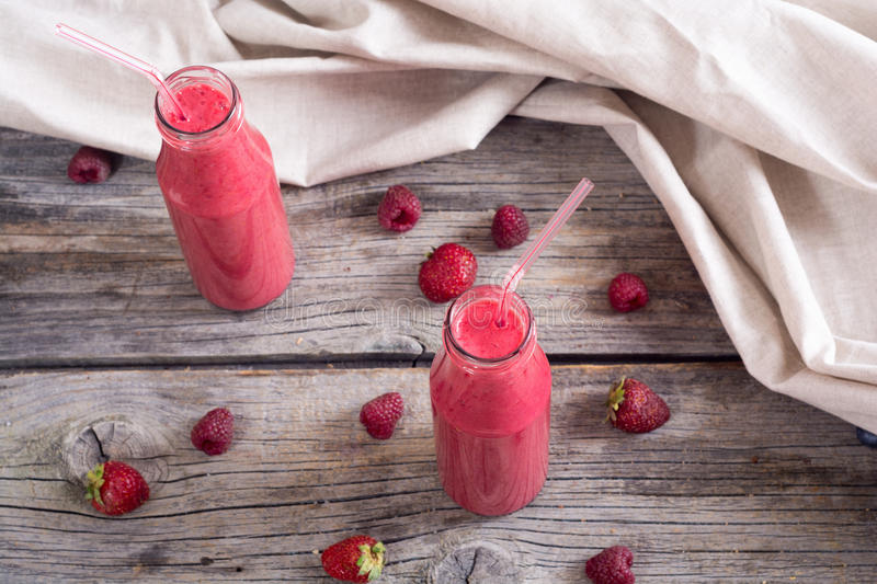 Fresh homemade smoothies. With berries on rustic background royalty free stock photos