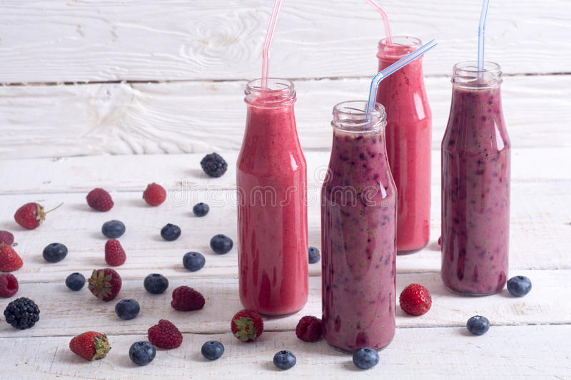 Fresh homemade smoothies. With berries on rustic background royalty free stock photo