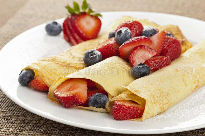 Fresh Homemade Strawberry Crepes. Fresh Homemade Rolled Strawberry Crepes with blueberries stock images