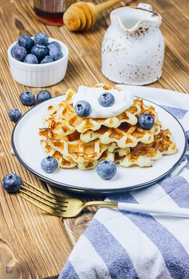 Fresh homemade waffles with blueberries for breakfast royalty free stock image