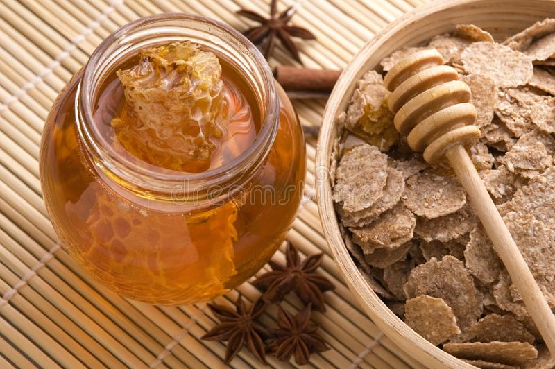 Fresh honey with honeycomb, spices and breakfast f royalty free stock photo