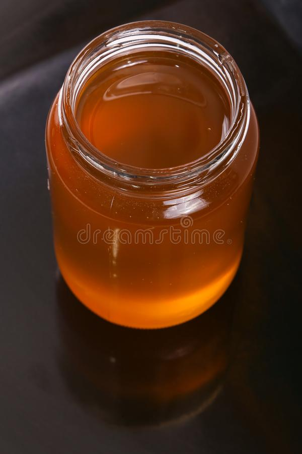 Jar of honey close up royalty free stock images
