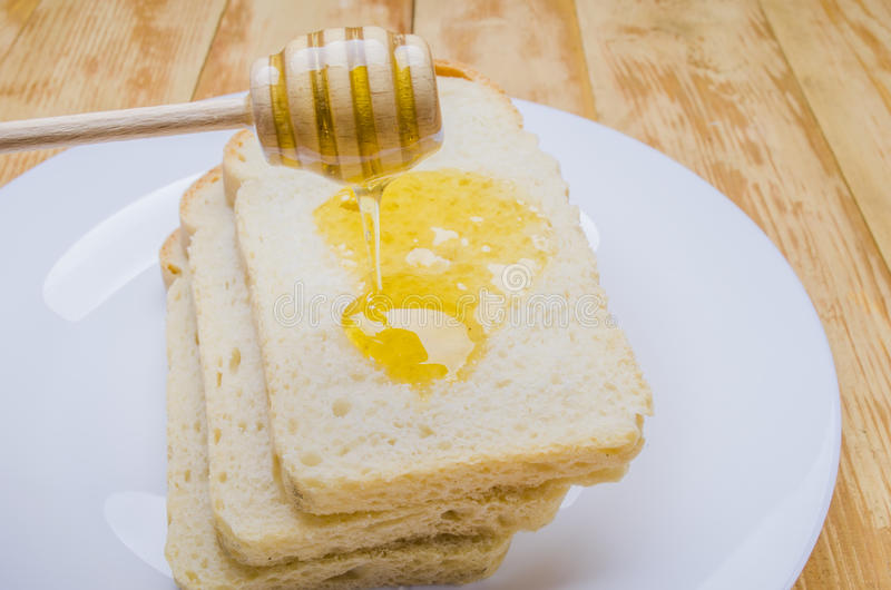 Fresh honey with a stick royalty free stock photo