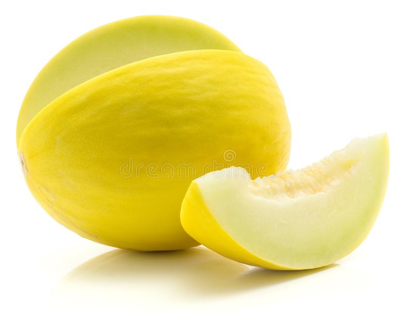 Fresh honeydew melon isolated on white. Yellow honeydew melon cut open with separated slice isolated on white background without seeds stock photo