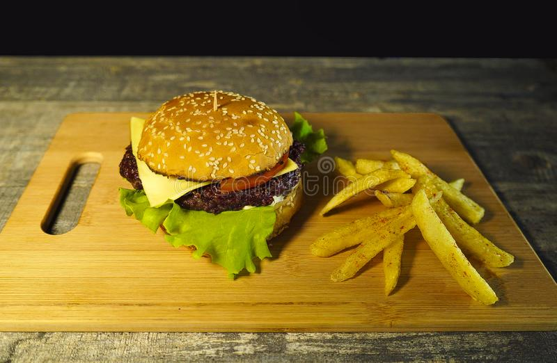 Fresh hot burger on a cutting board,cooking stock images