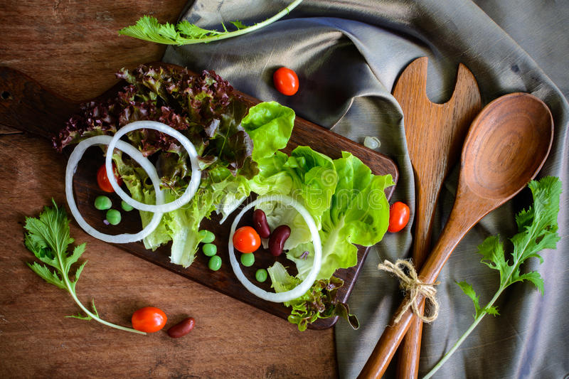 Fresh hydroponic salad on wooden table royalty free stock photography