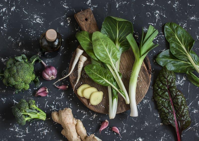 Fresh ingredients - chard, leeks, ginger, broccoli, garlic, soy sauce. royalty free stock photography
