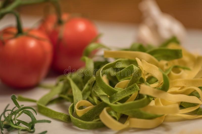 Fresh ingredients for fettuccini pasta stock photography