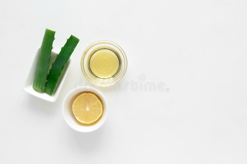 Fresh ingredients for homemade effective acne remedies on white background. Honey, sea salt, egg yolk, olive oil, oat, lemon and. Aloe. Flat lay. Copy space stock photography