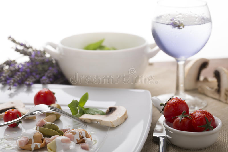 Fresh Italian pasta (tortellini) with cream royalty free stock photos