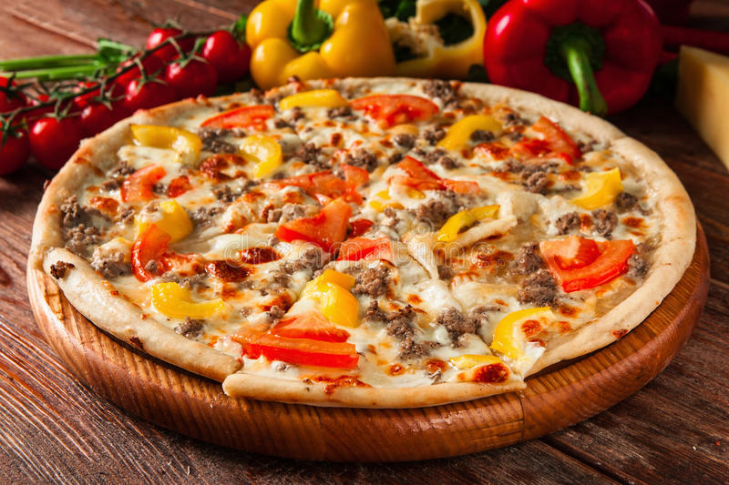 Fresh italian pizza of bright colors. Fast food. royalty free stock photography