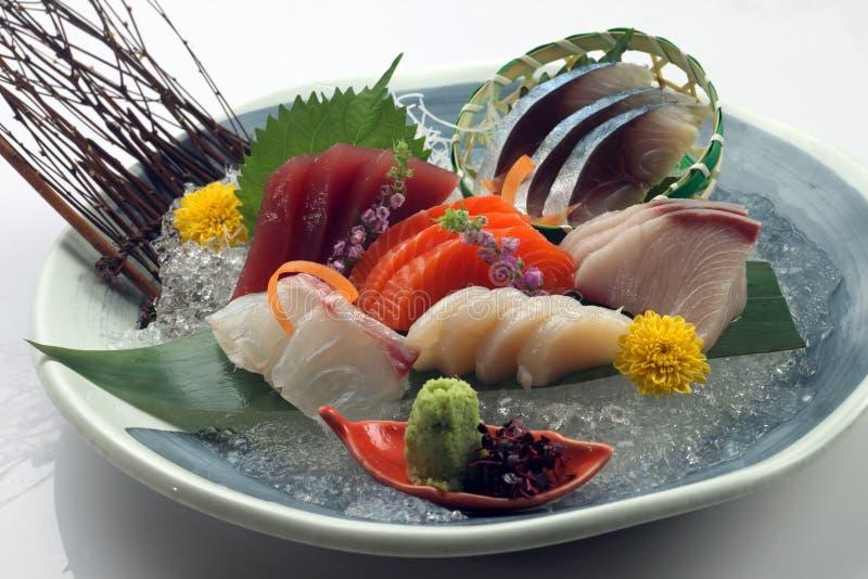 Fresh Japanese sashimi set. On plate stock images