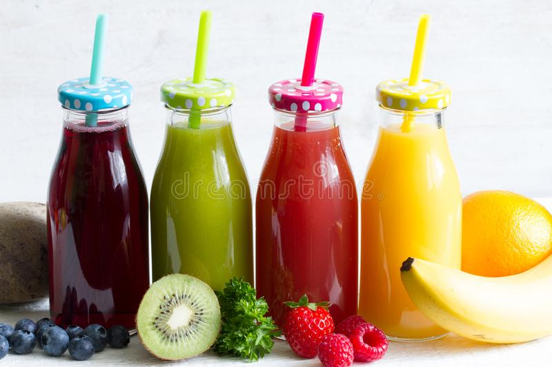 Fresh juice in the bottle and fruits healthy lilifestyle concept. Art royalty free stock photos