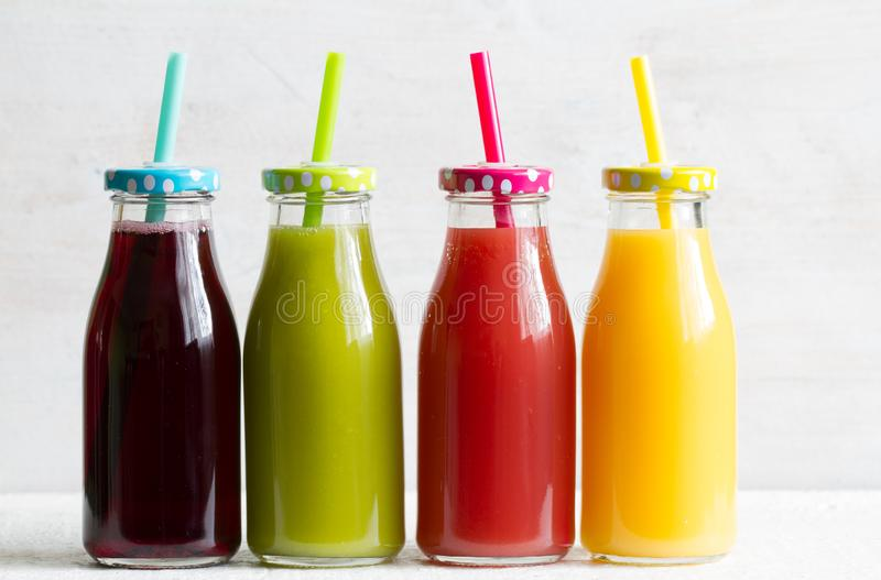 Fresh juice in the bottle and fruits healthy lilifestyle concept royalty free stock photo