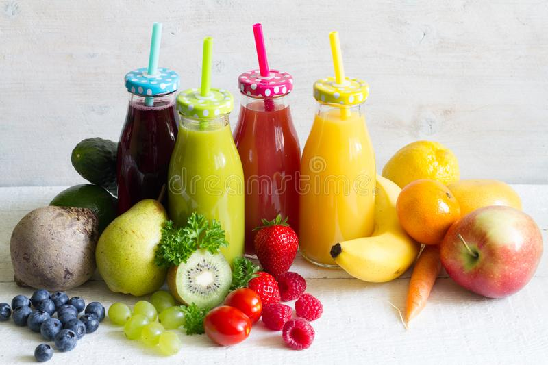 Fresh juice in the bottle and fruits healthy lilifestyle concept stock images