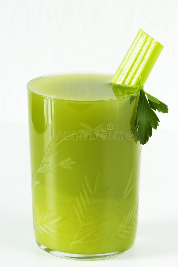 Fresh juice of celery, parsley in a glass Cup royalty free stock photos