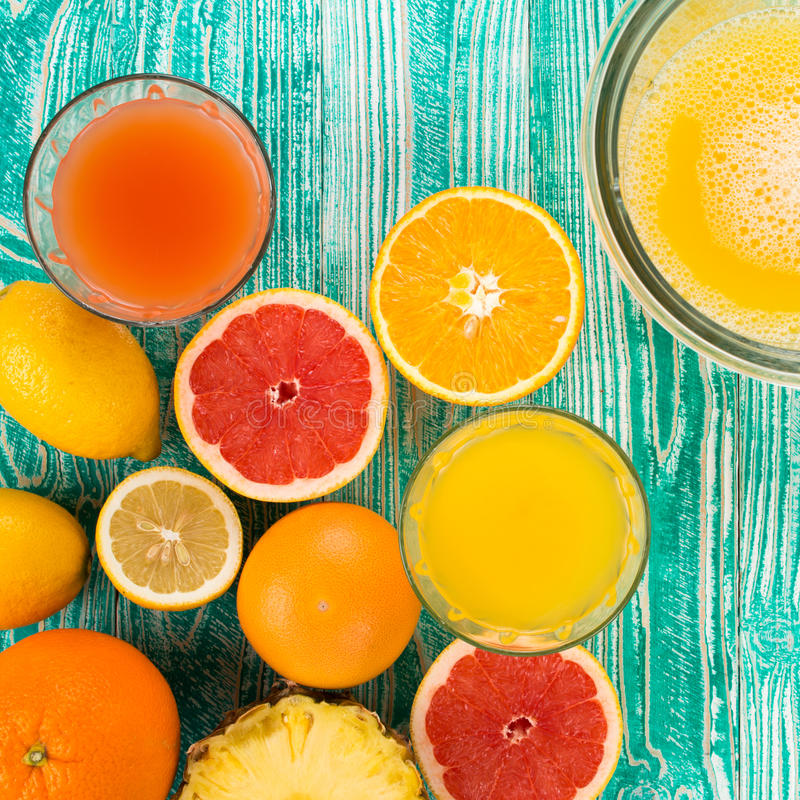 Fresh juice from citrus fruits royalty free stock photos