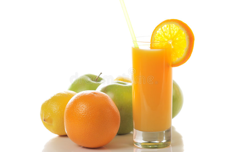 Fresh juice with fruits behind royalty free stock photography