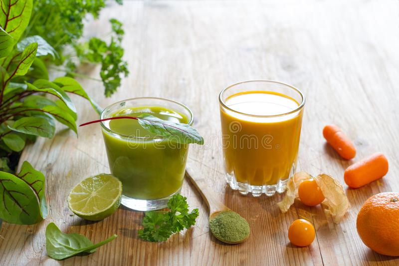 Fresh juice fruits and herbs healthy life style alternative medicine food concept. On wooden background royalty free stock photos