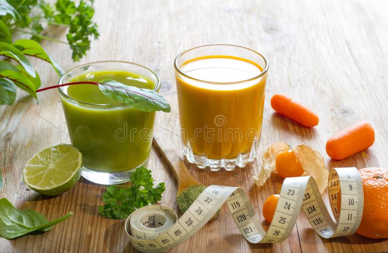 Fresh juice fruits and herbs healthy life style alternative medicine food concept. On wooden background stock photo