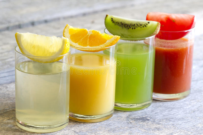 Fresh juice in glass with slices of fruits stock photography