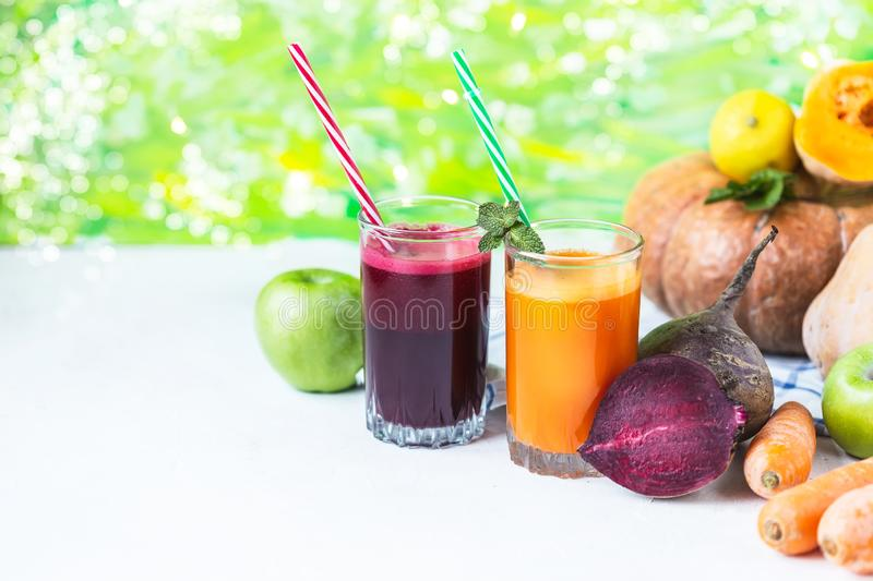Fresh juice from homemade vegetables. Beet and carrot smoothie. Detox, vegetarianism On a bright summer background stock photo