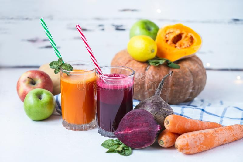 Fresh juice from homemade vegetables. Beet and carrot smoothie. Detox, vegetarianism On a bright summer background royalty free stock photography