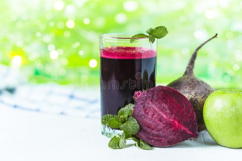 Fresh juice from homemade vegetables. Beet smoothie. Detox, vegetarianism On a bright summer background stock image