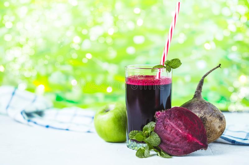 Fresh juice from homemade vegetables. Beet smoothie. Detox, vegetarianism On a bright summer background stock photography