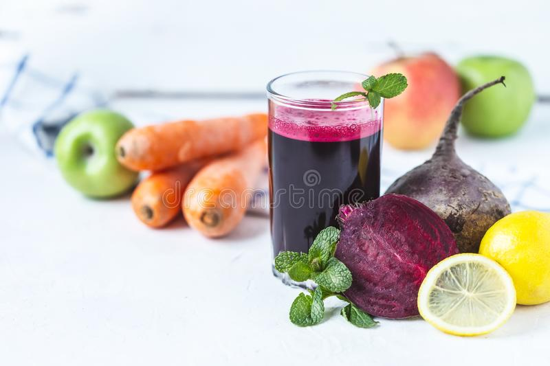 Fresh juice from homemade vegetables. Beet smoothie. Detox, vegetarianism On a bright summer background royalty free stock photos