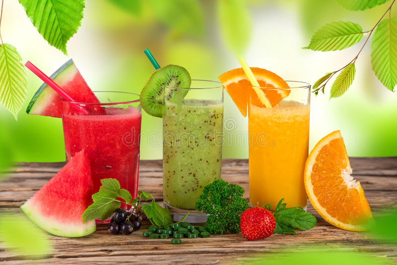 Fresh juice mix fruit. Healthy drinks on wooden table stock images