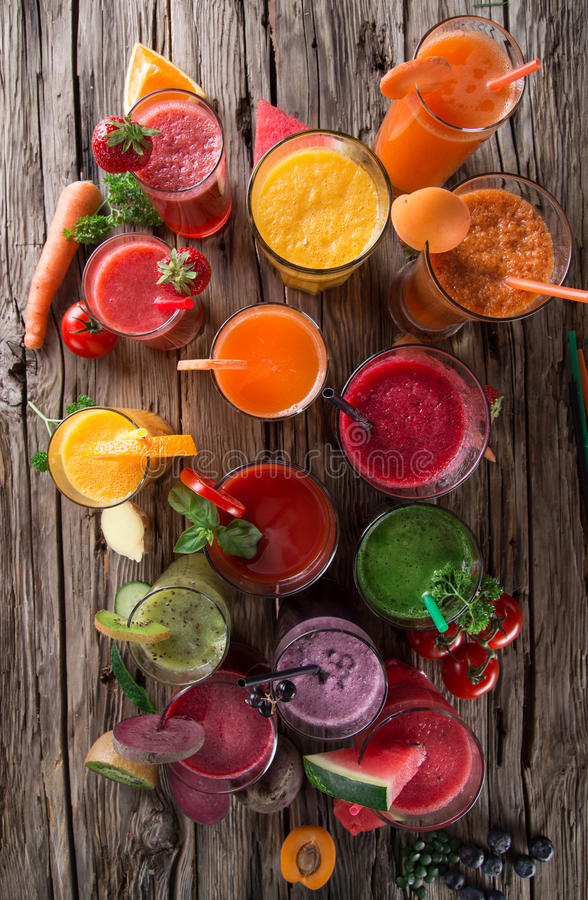 Fresh juice mix fruit. Healthy drinks on wooden table royalty free stock photography