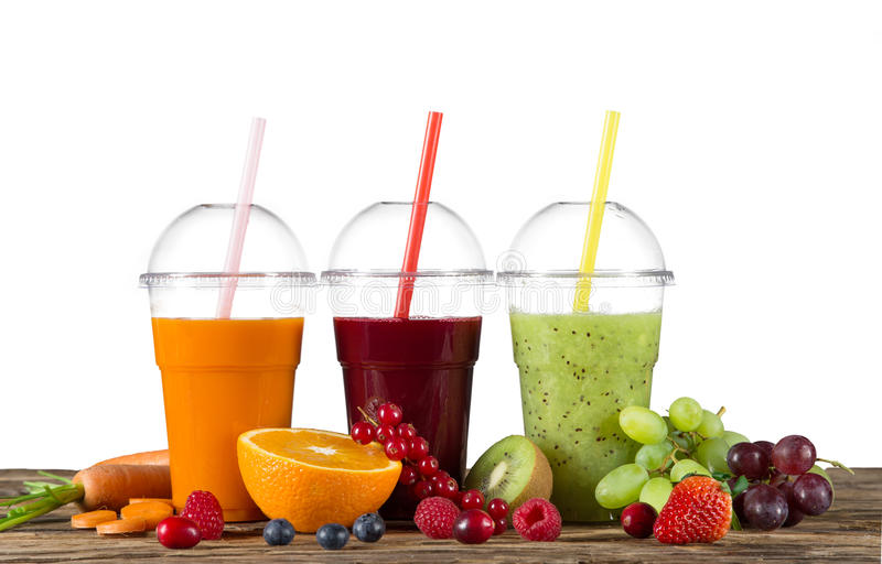Fresh juice mix fruit. Healthy drinks on wooden table stock photo