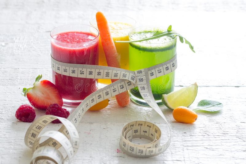Fresh juices measuring tape fruits and vegetables lose weight diet concept royalty free stock photos