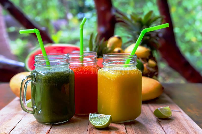 Fresh Juices Smoothie with tropical Fruits stock photos