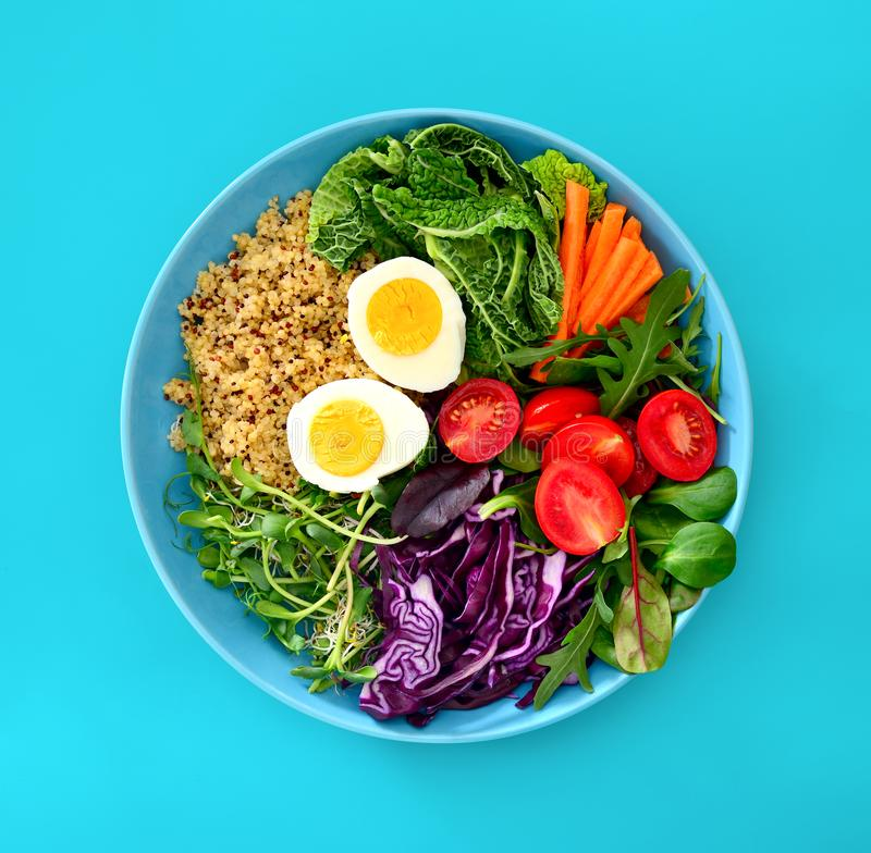 Fresh juicy and crusty buddha bowl healthy meal with quinoa and royalty free stock images