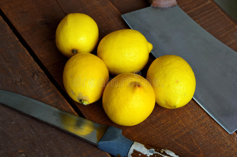 Fresh juicy lemon on top of the salad and fresh for the fish,. Knife and lemon pictures ready to cut on the table,Fresh juicy lemon on top of the salad and fresh stock image