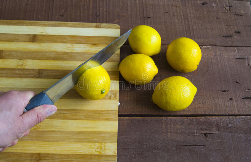 Fresh juicy lemon on top of the salad and fresh for the fish,. Knife and lemon pictures ready to cut on the table,Fresh juicy lemon on top of the salad and fresh royalty free stock images