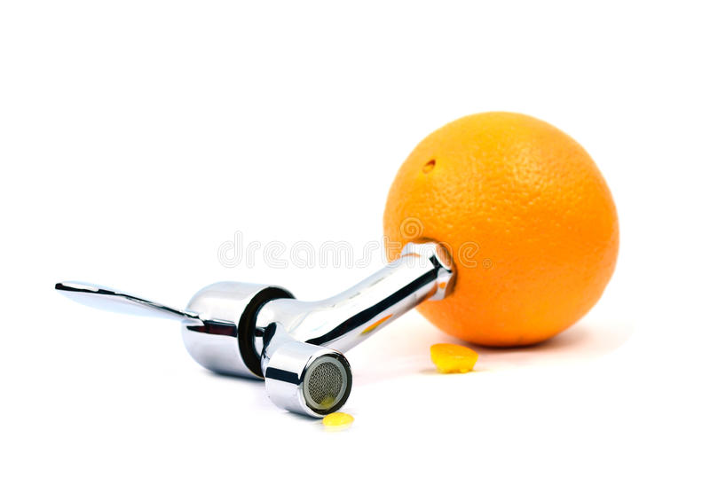 Fresh juicy orange. With faucet royalty free stock photos