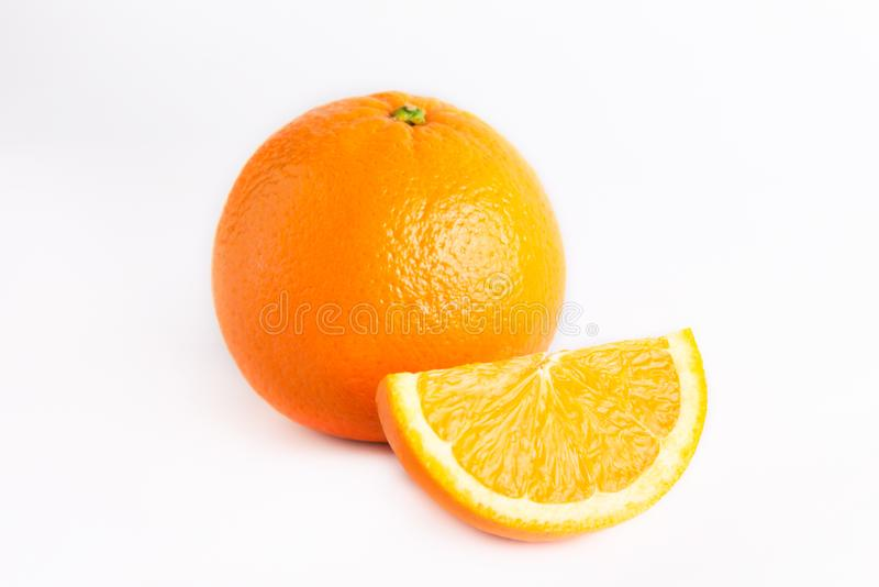 Fresh juicy orange and one lobule. Isolated on white background. Close photo. View from above royalty free stock images