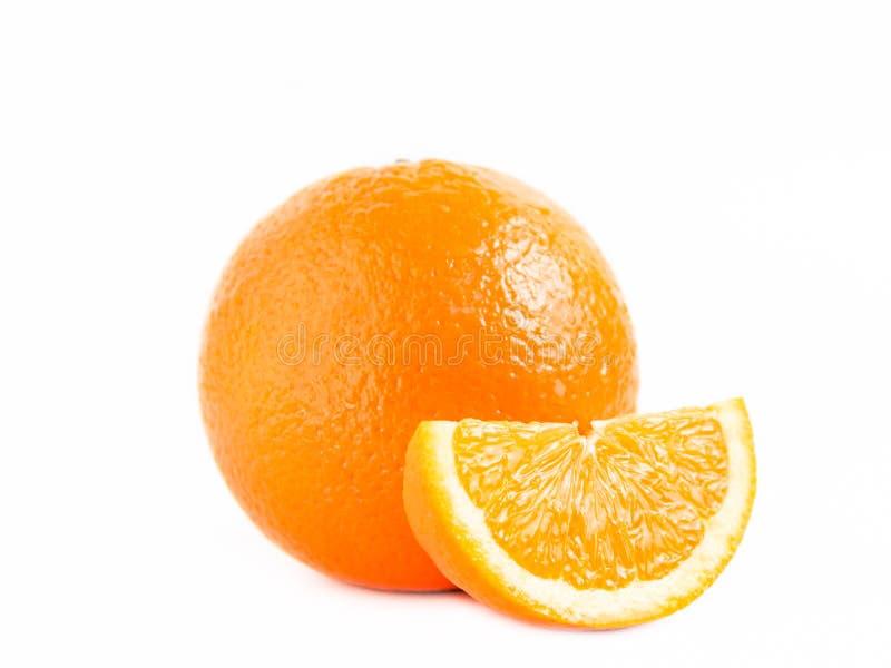 Orange and one lobule isolated on white background. Close photo. Fresh juicy orange and one lobule isolated on white background. Close photo. Side view stock photos