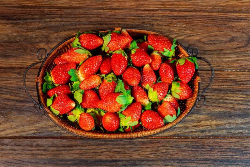 fresh juicy organic strawberries in a basket stock image